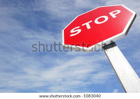 Stop sign on blue sky from below