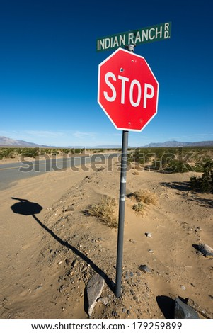 Stop sign on Indian Ranch road in Death Valley