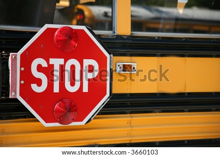 stop sign on the side os a school bus - stock photo