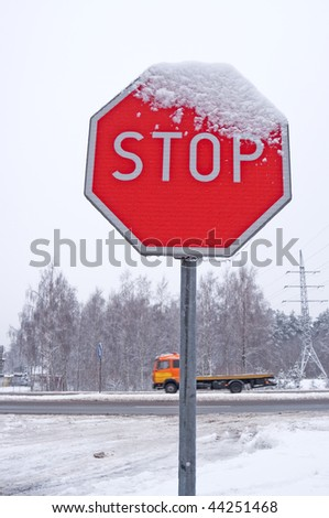 Stop Sign on Winter Road - stock photo