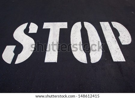 Stop sign painted on the road