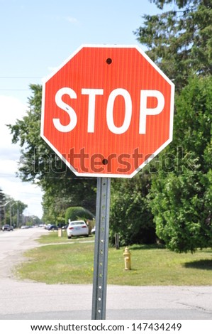 Stop sign posted in the street - stock photo
