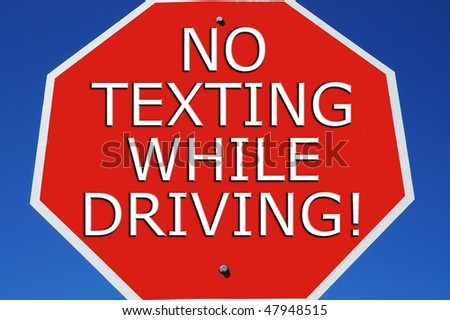 "Stop sign reading ""No Texting While Driving"""