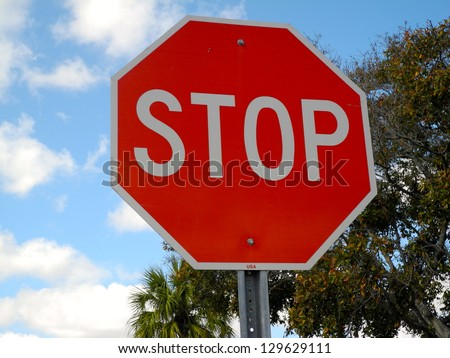 Stop Sign This is a regulation octagonal stop sign in red and white.