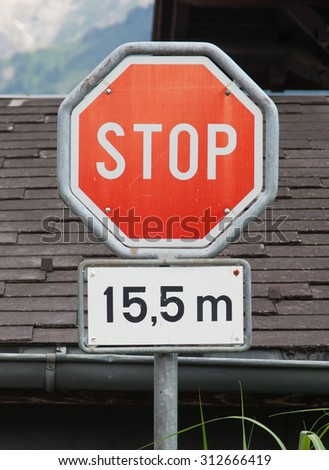 Stop sign (traffic stop sign), stop after 15,5 meters - stock photo