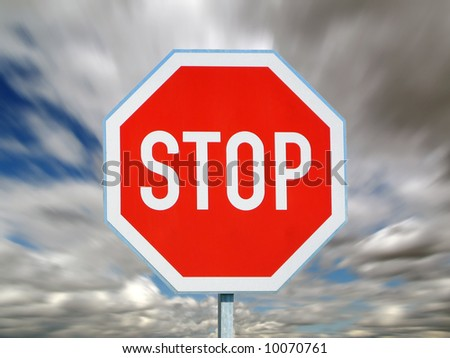 stop sign with blurred sky