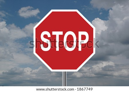 Stop sign with clouds in the background