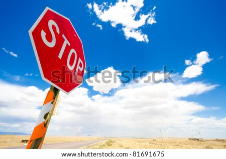 Stop signal in a summer sky - stock photo