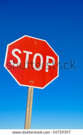 Stop signal in the blue sky - stock photo