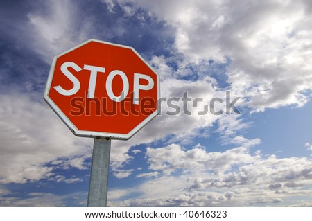 stop signal with cloudy sky - stock photo