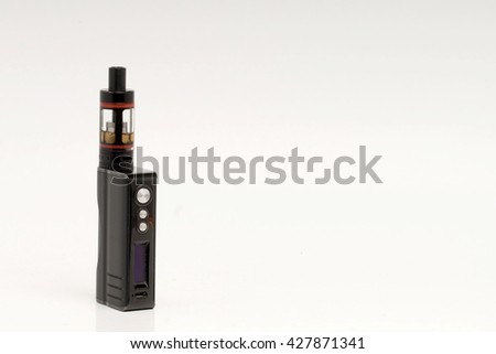 Stop smoking, start vaping. A black vape or electronic cigarette placed on the left on a shaded white background. - stock photo
