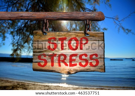 Stop stress motivational phrase sign on old wood with blurred background