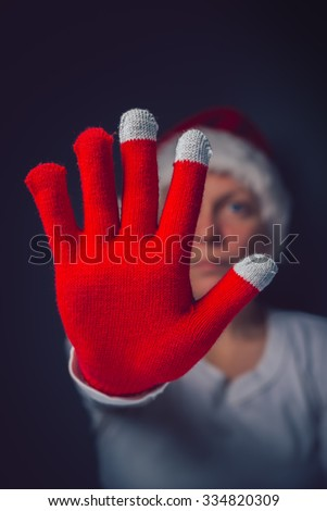 Stop the Christmas, beautiful woman in Santa Claus costume making Stop hand sign, retro toned image with selective focus - stock photo