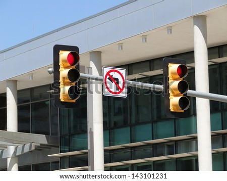 Stop traffic light, no left turn - stock photo
