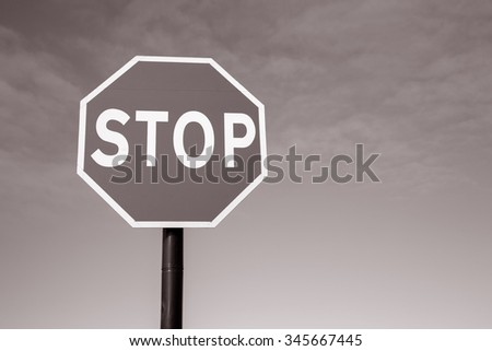 Stop Traffic Sign on Sky Background in Black and White Sepia Tone
