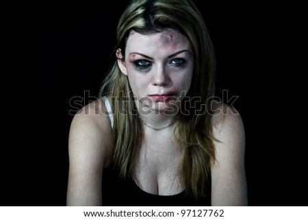 STOP Violence With Women, Beaten white woman with cuts and bruises with a black background - stock photo