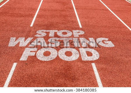 Stop Wasting Food written on running track