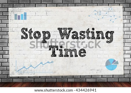Stop Wasting Time on brick wall and poster concept - stock photo