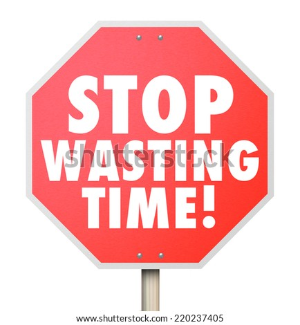 Stop Wasting Time words on a red road warning sign to help you better manage your hours and minutes for more efficiency and productivity - stock photo