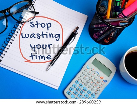 Stop wasting your time word on notebook - stock photo