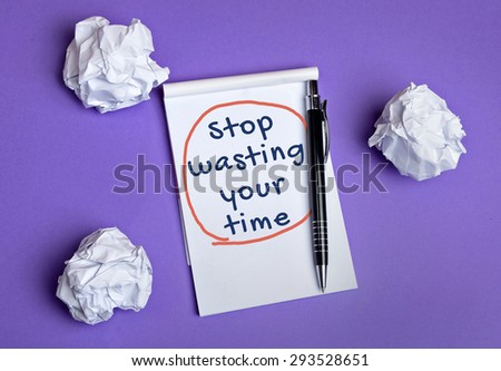 Stop wasting your time word on notepad - stock photo