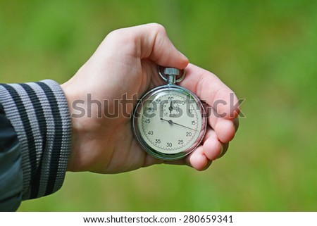 Stop watch in a hand  - stock photo