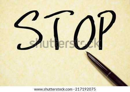 stop word write on paper - stock photo