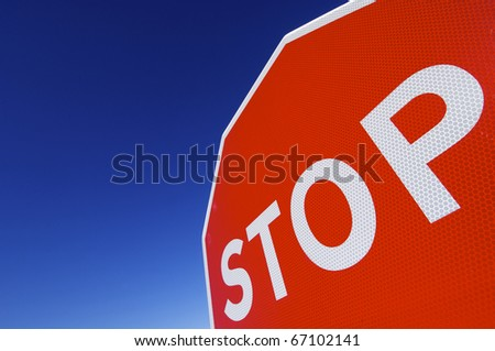 stop word written on a traffic signal - stock photo