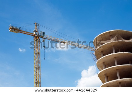 stopped construction of high-rise building. construction crane and unfinished high house - stock photo