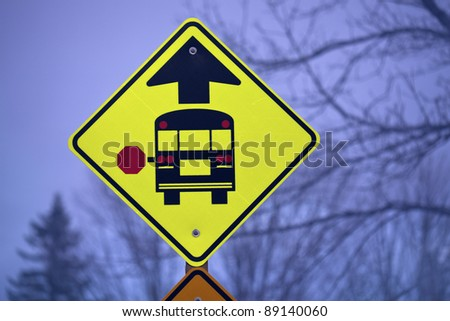 Stopped school bus sign - sign morning time in rural area - stock photo
