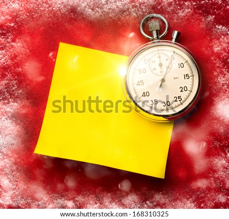 Stopwatch and blank sticker on red snowy background