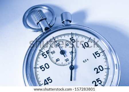 Stopwatch closeup in blue toning - stock photo