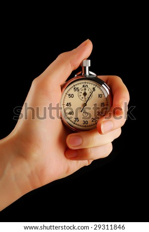 Stopwatch in female hand, isolated on black - stock photo