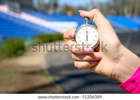 Stopwatch in hand, sports competition