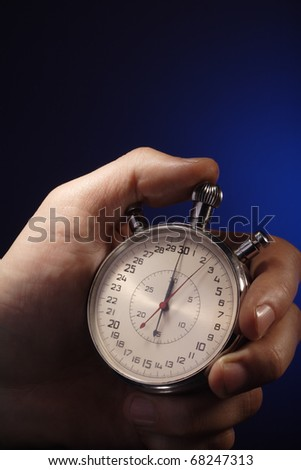 stopwatch in man hand