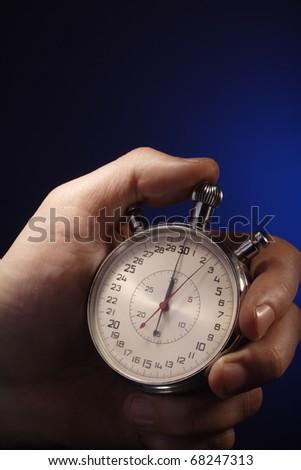 stopwatch in man hand - stock photo