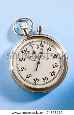 Stopwatch isolated on blue - stock photo