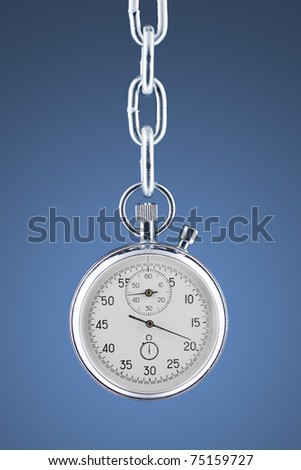 Stopwatch on a chain. Grey-blue gradient background. With clipping path. - stock photo