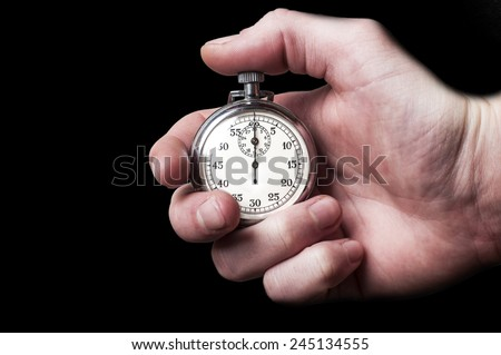 Stopwatch on black background - stock photo