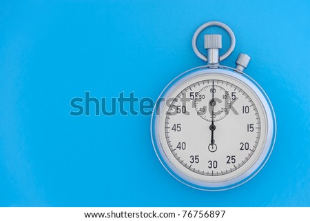 Stopwatch on blue background. The device for time gauging - stock photo