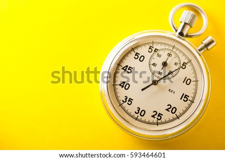 Stopwatch on yellow background in closeup
