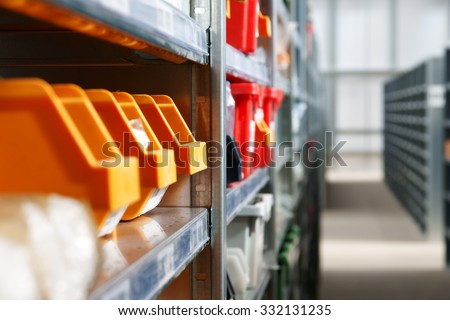Storage bins and racks in a warehouse shot with shallow focus - stock photo