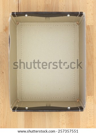 Storage boxes isolated on a wooden shelf - stock photo