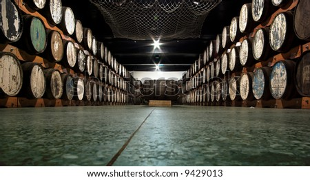 storage cellar with a lot of wine barrels.. well i dont know if its wine, might also be some other kind of alcohol - stock photo