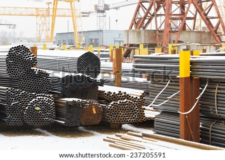 storage of metal pipes in outdoor warehouse with gantry cranes