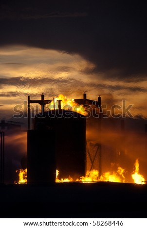 storage tank on fire - stock photo