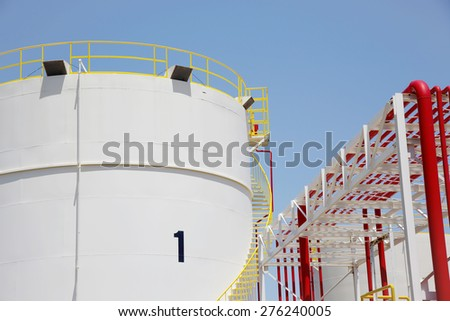 Storage tanks in a refinery plant - stock photo