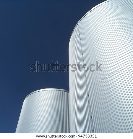 Storage Tanks in front of blue sky - stock photo