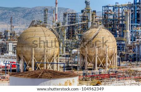 Storage tanks in oil refinery - stock photo