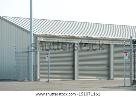 Storage unit facility with security fence.